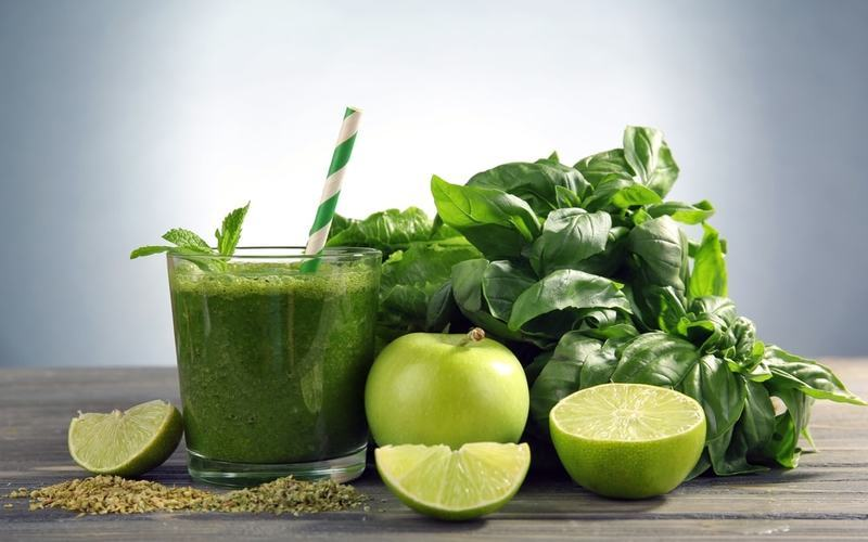 Fresh green smoothie with green fruits and herbs