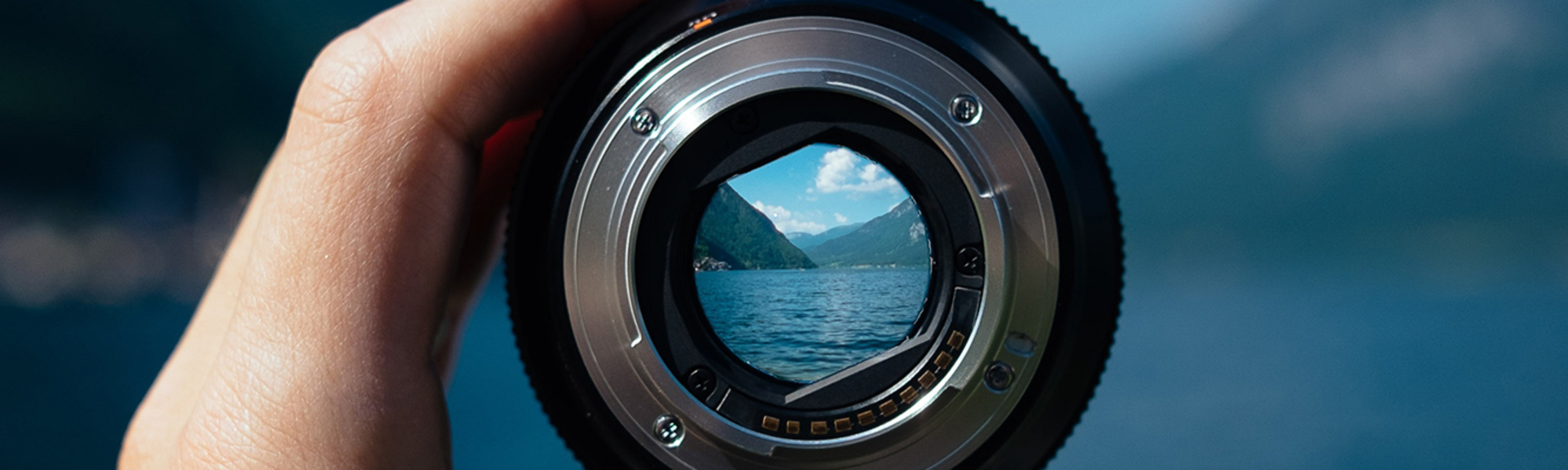 Looking through a camera lens at the water