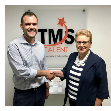 Sandra Chiles and John Terry shaking hands completing the sale of inPlace Recruitment to TMS Talent
