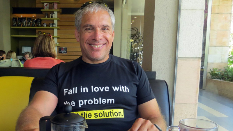 Uri Levine smiling while sitting in a cafe
