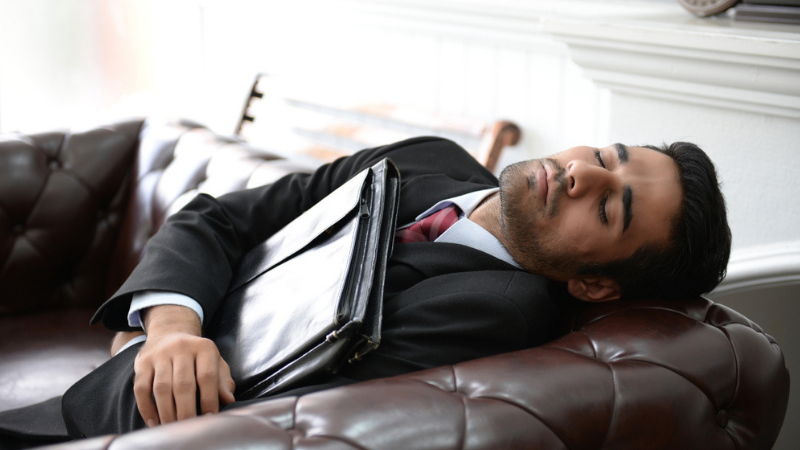 man asleep on sofa before interview