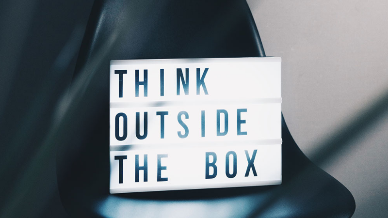 light box on chair with the words think outside the box