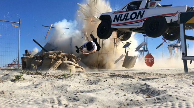 Judd Wild performing high-action stunts, car wreckage