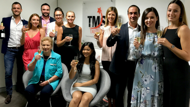 TMS talent team with inPlace recruitment team celebrating with champagne glasses