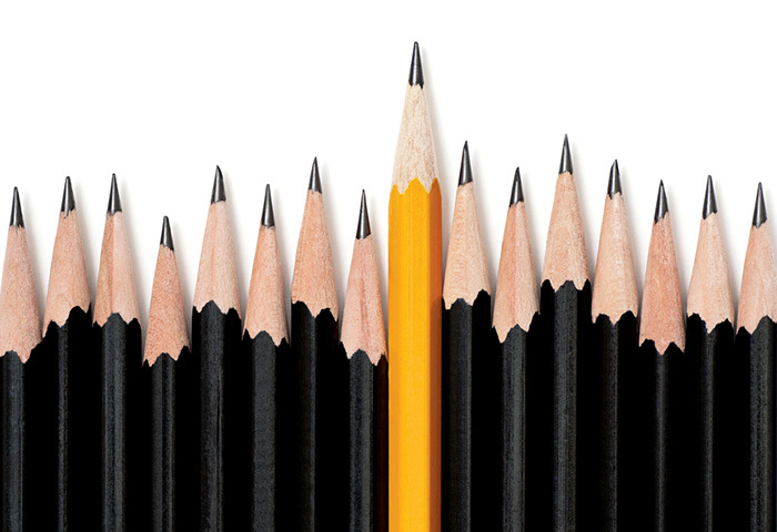Alt = gold pencil amongst black representing diversity