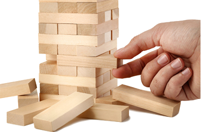 Alt = person playing jenga