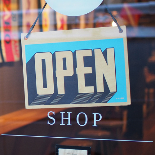 Store window with an 'open' sign