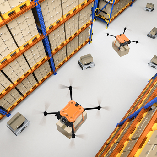 Drones carrying boxes in a warehouse