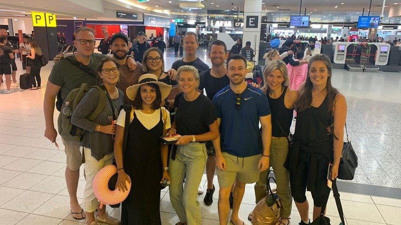 Group of people smiling at an airport