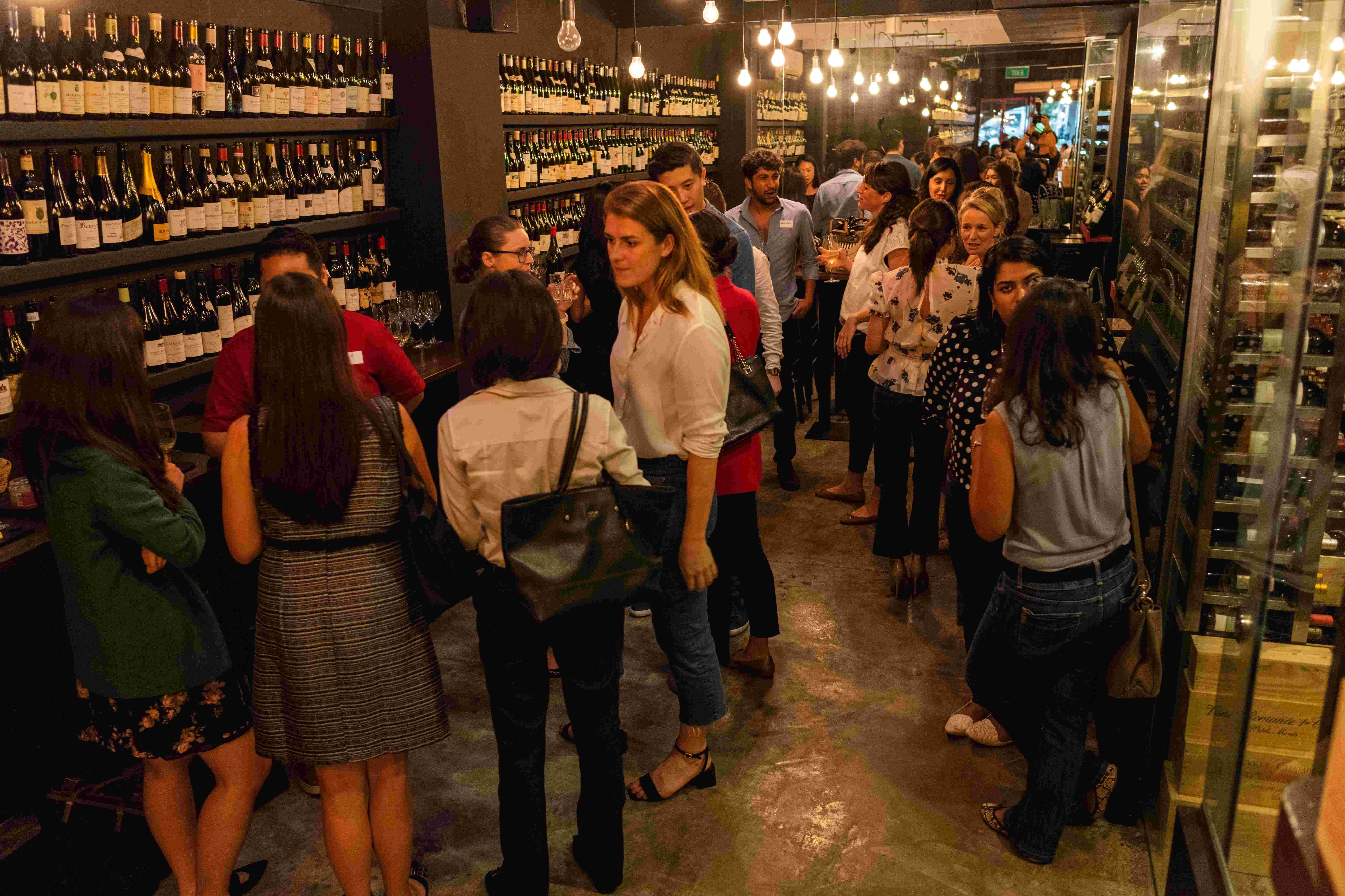 group of people in wine bar